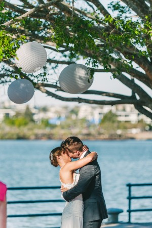 The bride and groom kiss