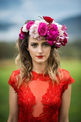 bride in red dress with red lips