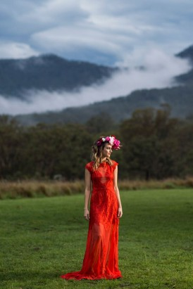 bride in red lace dress