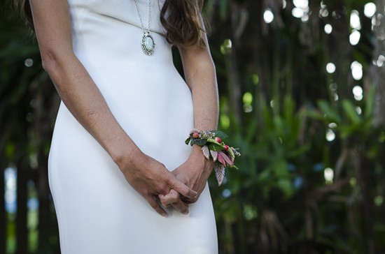 bride wearing wrist corsage