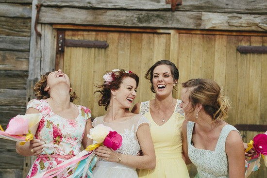 bride with bridesmaids in yelllow and mint