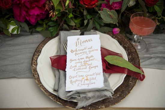 calligraphy menu on grey napkin