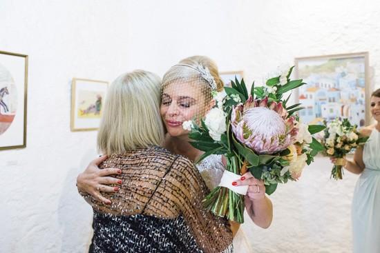 Bride with birdcage veil and protea bouquet