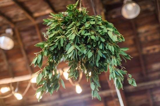 Green chandelier at wedding