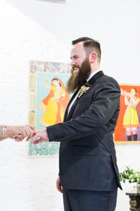 Groom at Art gallery wedding