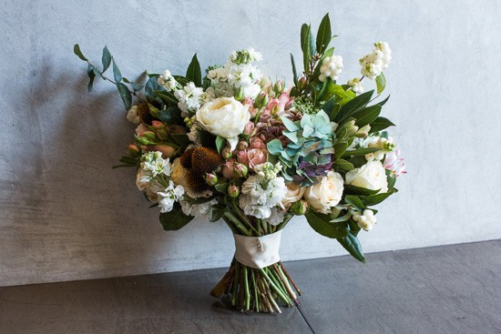 White stock pink roses snow berries and white rose bouquet