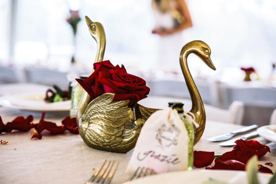 brass swan wedding decor