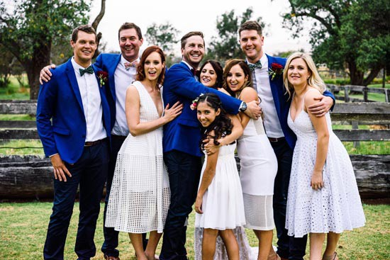 bridal party in blue and white