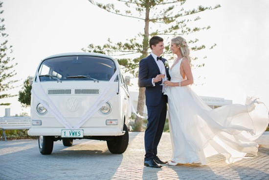 bride and groom with white kombi