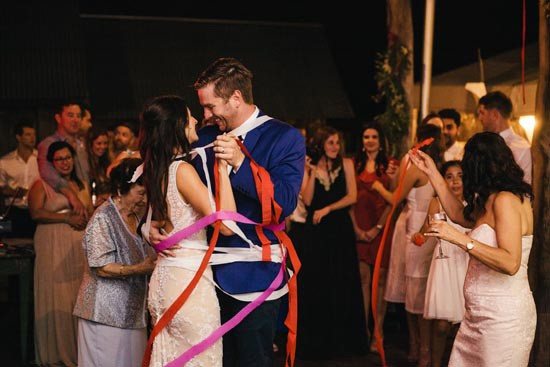 bride and groom wrapped in streamers