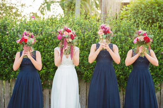 bridesmaid sin navy with pink and red bouquets