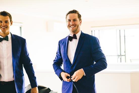 groom in blue jacket