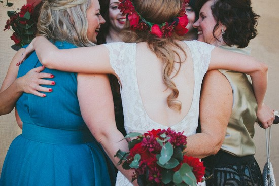 Bride and bridesmaids hugging