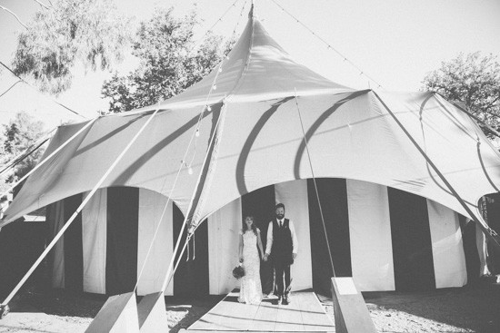 Bride and groom under tent
