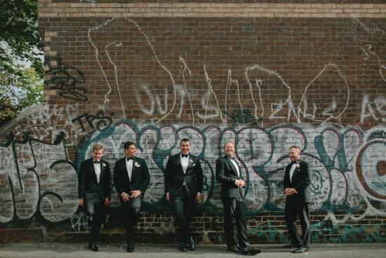 Groo and groomsmen against graffiti wall