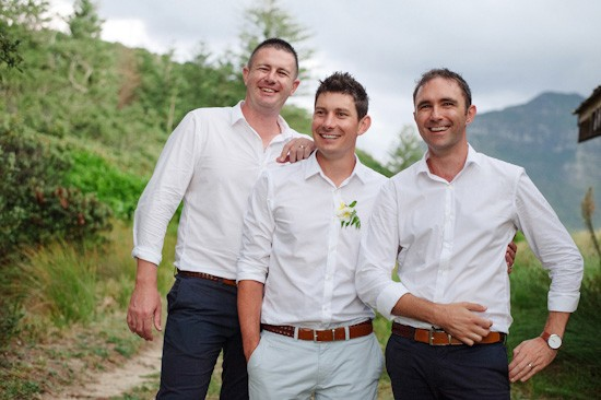 Groom and groomsmen in pale blue