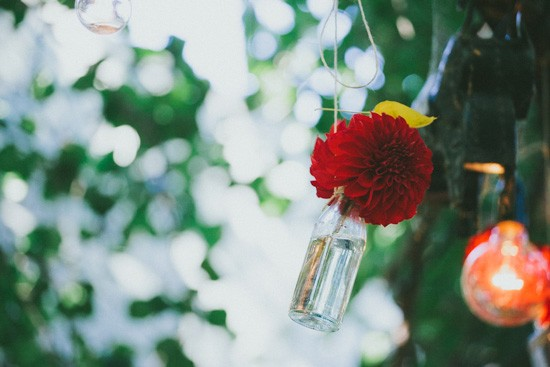 Hanging bottles of flowers