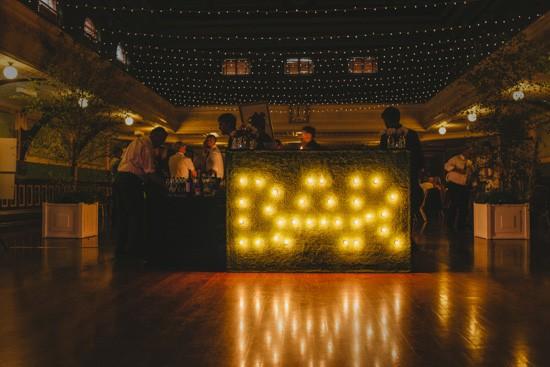 Lit up bar sign at wedding