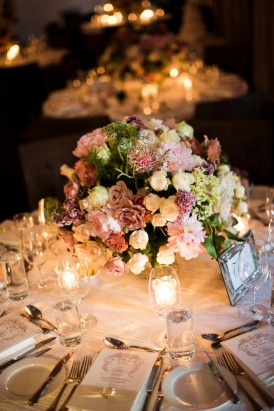 Rose and candle wedding centrepiece