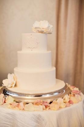 Three tier white wedding cake with sugar flowers