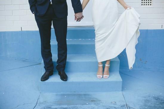 Bride and groom on blue steps