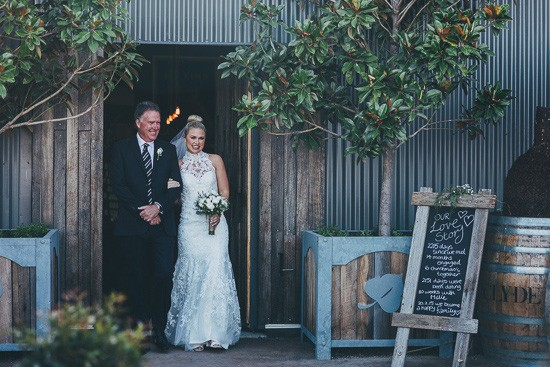 Bride at winery entrance