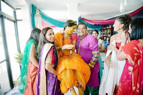 Bride being carried with haldi paste