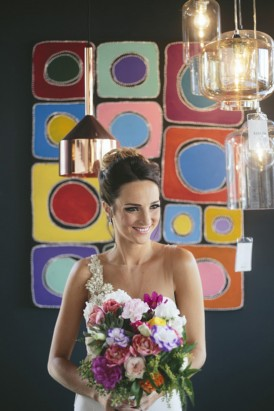 Bride in front of colourful wall