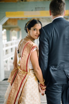 Bride in sari with groom in suit