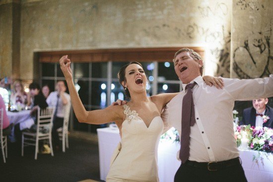 Bride sining with father