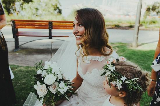 Bride with flowergirl at Jewish wedding