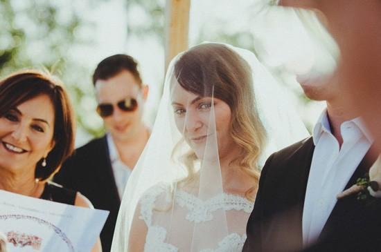 Briden under veil in Jewish ceremony