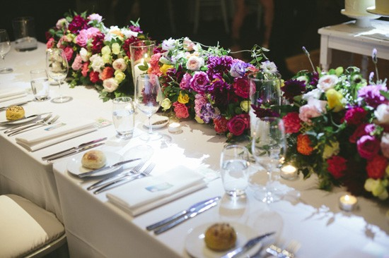 Colourful flowers on wedding head table