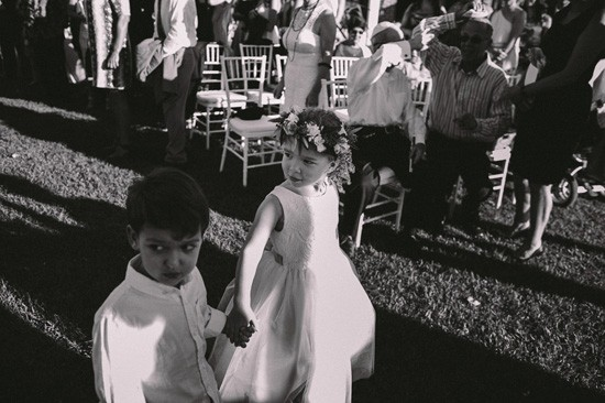 Flowergirl and page boy walking down aisle