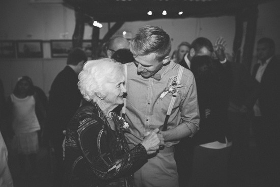 Groom dancing with grandmother