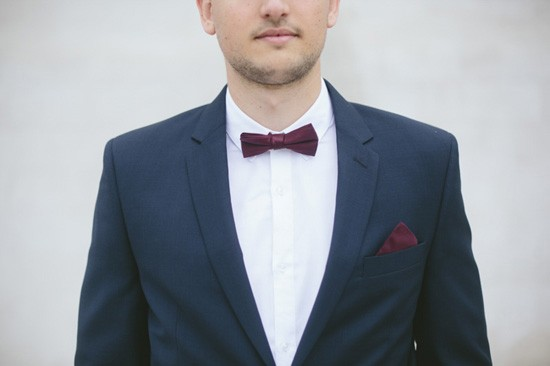 Groom with burgundy bow tie