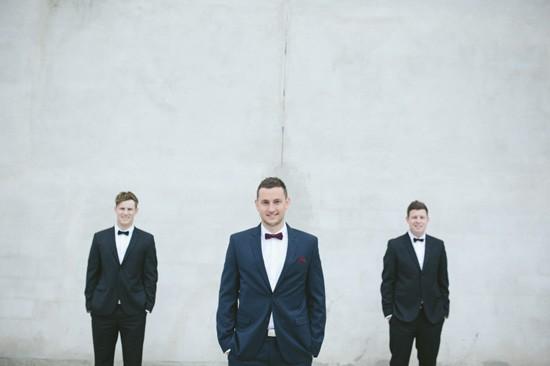 Groom with groomsmen in tuxedos