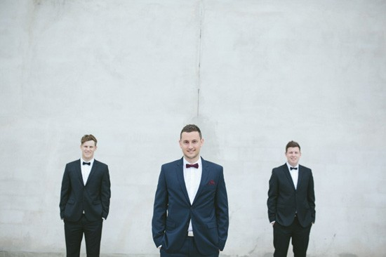 Groom with groomsmen in tuxedos