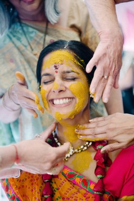 Painting bride with haldi paste