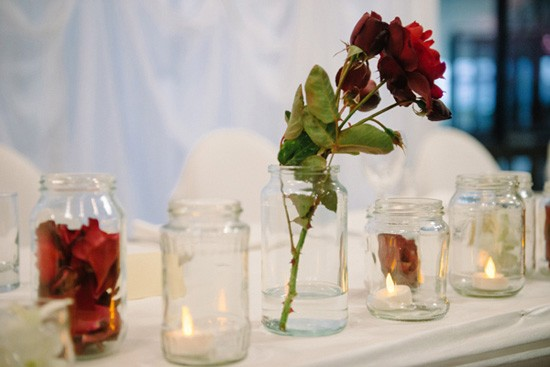 Red rose and candle wedding centrepieces