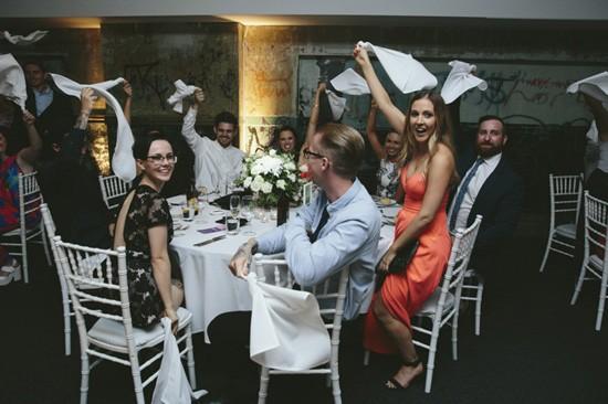 Waving napkins at wedding