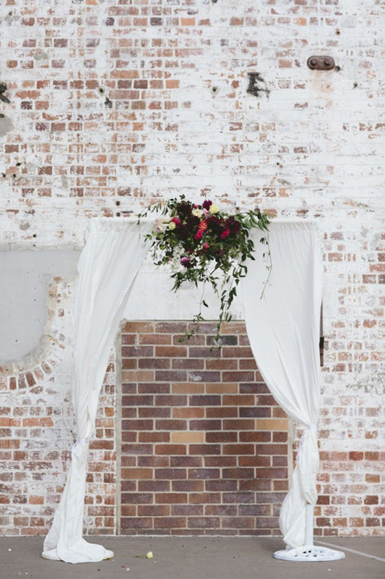 Wedding arch in front of brcick wall