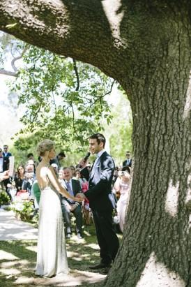 Wedding ceremony under oak tree