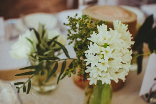 White flowers and greenery at wedding