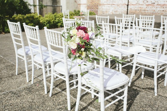 White tiffany chairs with flowers