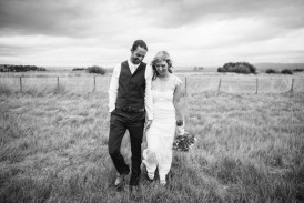 Black and white photo of newlyweds in grass