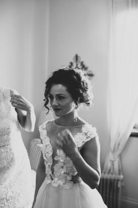 Bride in illusion neck Calra Zampatti dress