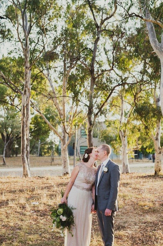 Bride kissing groom in Canberra