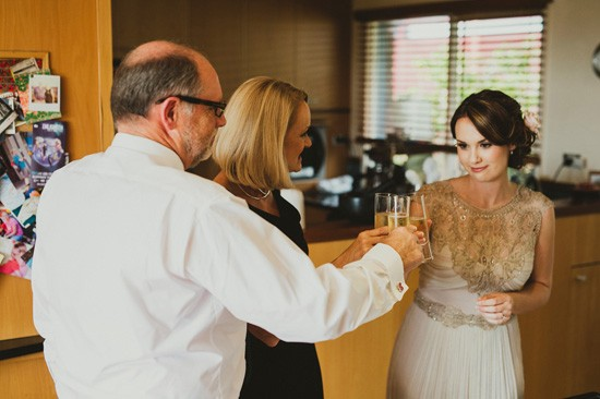 Bride toasting champagne with parents