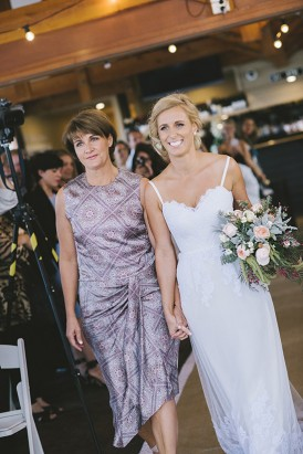 Bride walking gown the aisle with her mother